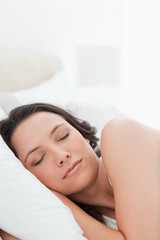 Close-up of a young woman in a peaceful sleep
