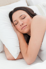 Close-up of a woman sleeping in a bed