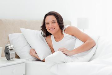 Cute woman wakes up