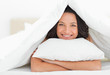 Cute woman hugging a pillow