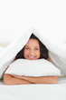 Close-up of a cute woman hugging a pillow