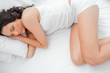 High angle shot of an attractive young woman sleeping