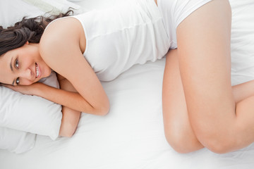 Attractive woman lying in her bed