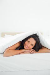 Attractive woman under the duvet