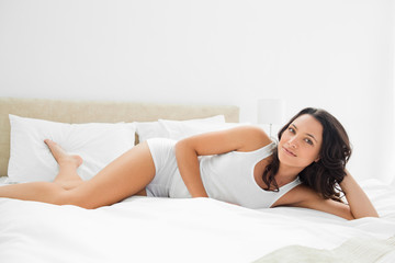 Sensual woman in a bed