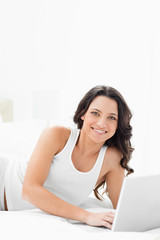 Smiling woman on a laptop