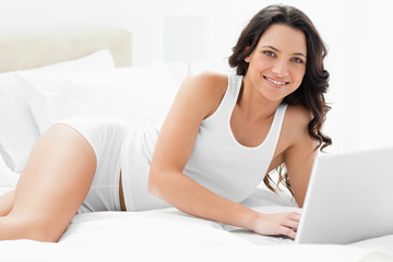 Close-up of a sexy woman on a laptop
