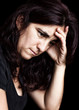 Depressed and sad woman isolated on black