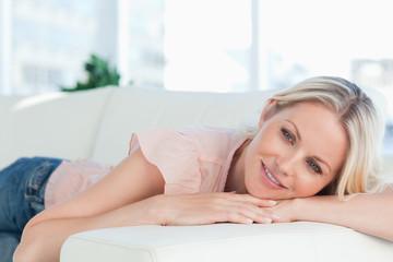 Cute pink shirt woman lying on her sofa