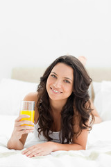 Close-up of an attractive brunette with an orange juice