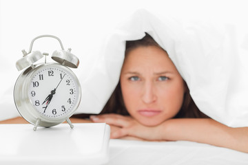 Alarm clock with a woman sulking