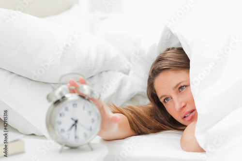 Woman turning off her alarm