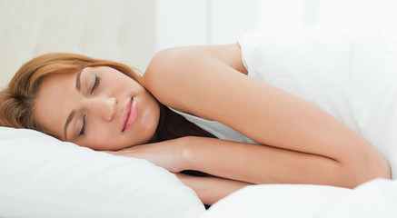 Redheaded young woman sleeping