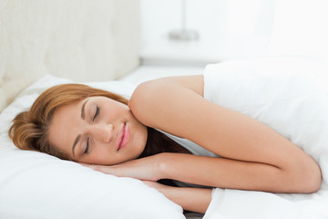 Redheaded woman sleeping deeply