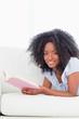 Portrait of a happy  woman reading a novel
