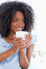 Close-up of a woman holding a cup of tea