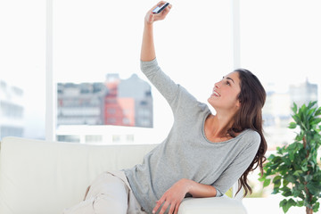 Woman taking a picture of herself