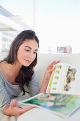 Close-up of a student reading a magazine