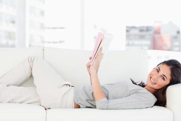 Portrait of a brunette lying on her sofa