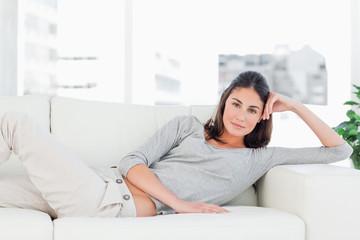 Brunette on her sofa