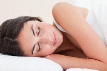 Close-up of a brunette sleeping peacefully