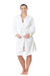 Beautiful woman standing wearing bathrobe.