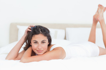 Portrait of a seductive brunette in her bed