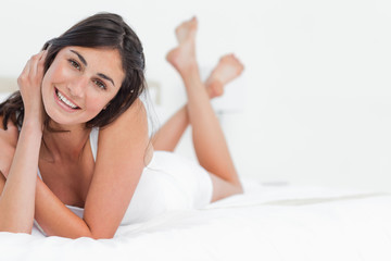 Portrait of a attractive woman on a bed