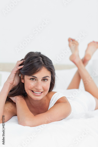 Portrait of a beautiful woman on her bed