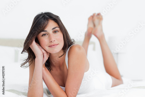 Portrait of a charming woman on her bed