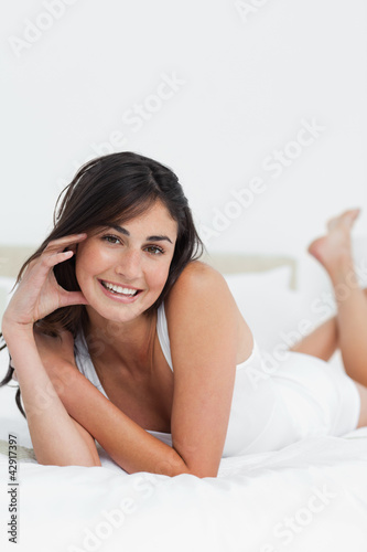 Portrait of a happy woman on her bed