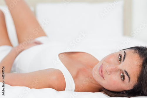 Portrait of a brunette lying on her back