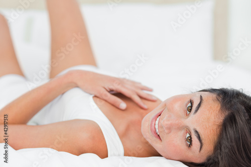 Portrait of a charming brunette lying on her back