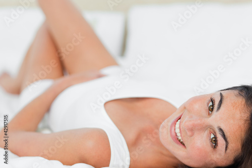 Portrait of a cute woman lying on her back