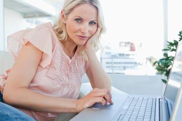 Portrait of a blonde on a laptop