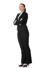 Businesswoman standing and smiling.