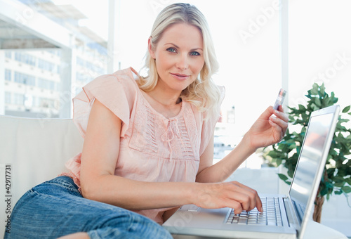 Portrait of a blonde shopping online