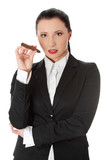 Young businesswoman is holding cigar.