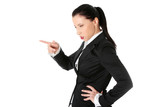 Upset businesswoman is standing sideways and pointing.