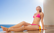 Woman sitting on the pool edge