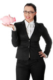Businesswoman is showing pink piggybank.