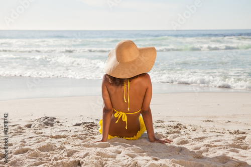 Rear view of a young woman looking at the ocean