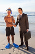 Young man in a snorkeling equipment meeting a businessman