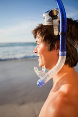 Young attractive man wearing a snorkel and a mask