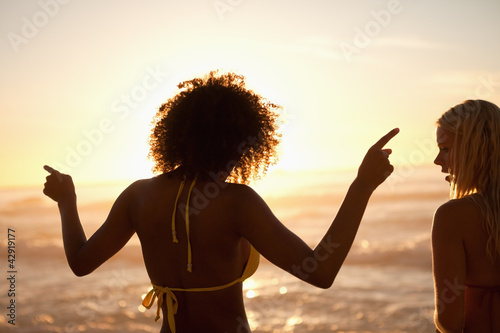 Young woman dancing on the beach