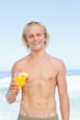 Man wearing a swimsuit while holding a cocktail