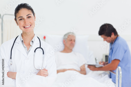 Doctor smiling while crossing her arms