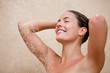 Smiling woman enjoying a shower