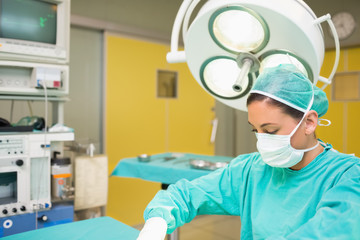Female surgeon next to the operating table