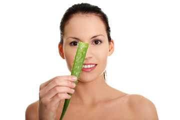 Young beautiful woman is showing aloe vera.